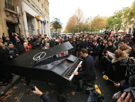 An unnamed man brings his portable grand piano and plays John Lennon's Imagine by the Bataclan, Paris, one of the venues for the attacks in the French capital which are feared to have killed around 120 people.
