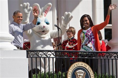 President Barack Obama and first lady Michelle Obama wave with the Easter Bunny as they greet families participating in the White House Easter Egg Roll on the South Lawn of White House in Washington, Monday, April 6, 2015. Thousands of children gathered at the White House for the annual Easter Egg Roll. This year's event features live music, cooking stations, storytelling, and of course, some Easter egg roll. (AP Photo/Jacquelyn Martin)