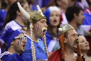 French fans sporting gauls' helmets sing prior to the men's semifinal handball match France vs Germany for the Rio 2016 Olympics Games at the Future Arena in Rio on August 19, 2016. / AFP / afp / JAVIER SORIANO (Photo credit should read JAVIER SORIANO/AFP/Getty Images)