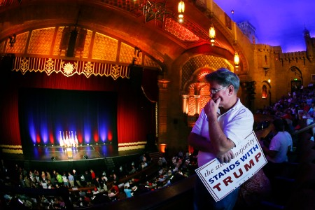 Tim Youngblood of Dahlonega, Ga. waits for Republican presidential candidate Donald Trump to arrive for a rally at the Fox Theater, Wednesday, June 15, 2016, in Atlanta. (AP Photo/John Bazemore)