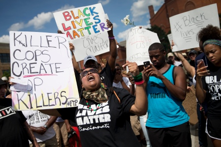 Protestors rally during a Black Lives Matter demonstration, Sunday, July 10, 2016, in Cincinnati. More than a thousand protested against the shootings of black men by police officers. (AP Photo/John Minchillo)