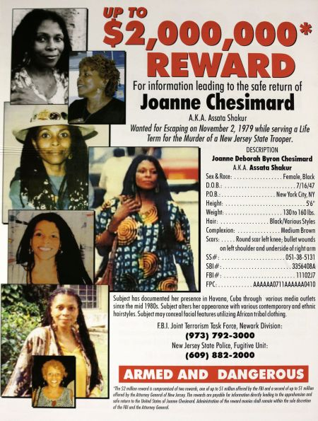 A poster with photographs of Joanne Chesimard, a fugitive for more than 30 years, is on display during a news conference giving updates on the search of Chesimard, Thursday, May 2, 2013, in Newark, N.J. The reward for the capture and return of convicted murderer Chesimard, one of New Jersey¿s most notorious fugitives, was doubled to $2 million Thursday on the 40th anniversary of the violent confrontation that led to the slaying of a New Jersey state trooper. The FBI also announced it has made Chesimard, now living in Cuba as Assata Shakur, the first woman on its list of most wanted terrorists. (AP Photo/Julio Cortez) NJ Trooper Shot Cuba