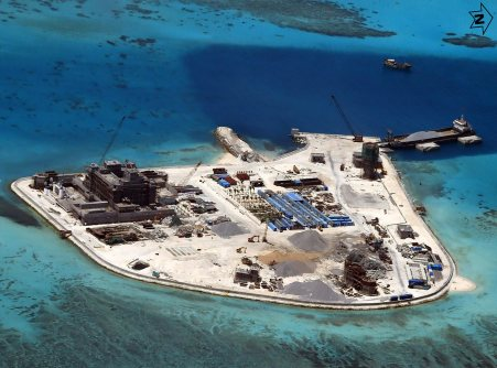 epa04712851 A handout picture made available by the Armed Forces of the Philippines (AFP) Public Affairs Office on 20 April 2015 shows construction at Mabini (Johnson) Reef in the disputed Spratley Islands in the south China Sea by China on 18 February 2015. Just before the opening of the Balikatan 2015 joint Philippines and US military exercises, Philippine military chief General Gregorio Pio Catapang showed the latest aerial photos of the expansive reclamation and building being done by China in at least seven disputed territories. The Philippines has alleged that China causes economic losses of at least 100 million dollars annually due to its reclamation activities, which have destroyed an estimated 120 hectares of coral reef systems in the Spratlys islands group. EPA/ARMED FORCES OF THE PHILIPPINES HANDOUT EDITORIAL USE ONLY/NO SALES